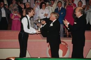 1989 Snooker fans brandishing a variety of cameras get ready to picture Steve Davis hoist the World Championship trophy into the air after he beat John Parrott 18-3 to take the title