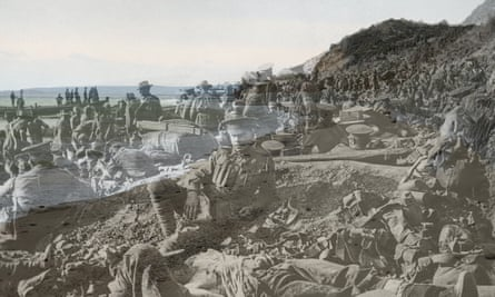 25 April 1915: An Australian soldier lies wounded in the foreground, as hundreds of other troops move among the dead and wounded on the beach at Anzac Cove.
