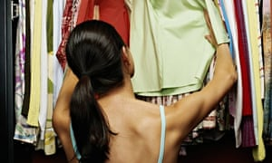 A woman choosing clothes from her wardrobe