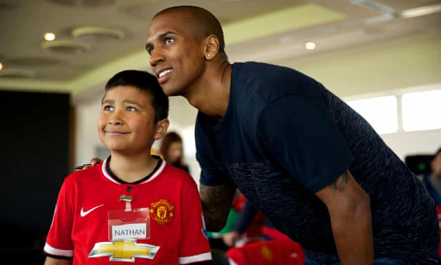 Ashley Young with a young Manchester United supporter on the club's Dream Day, held at the Aon Training Complex.