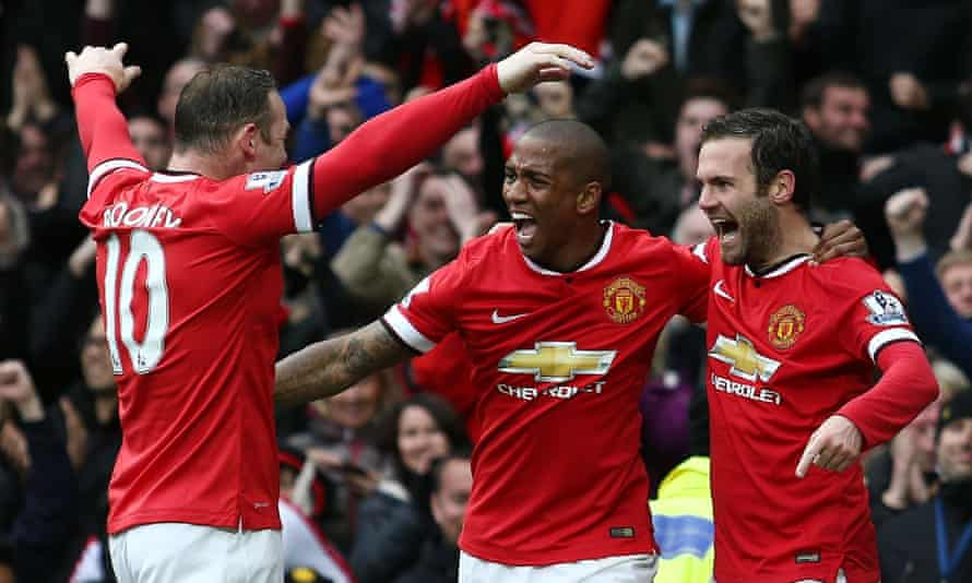 Ashley Young, middle, celebrates with Wayne Rooney, left, and Juan Mata after the latter's goal against Manchester City in the 4-2 win on 12 April, 2015.