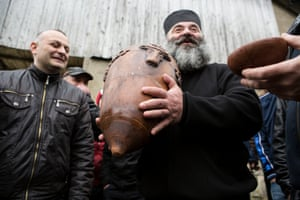The ball weighs 18 kilograms. As the locals add the filling to the ball, the priest blesses the players