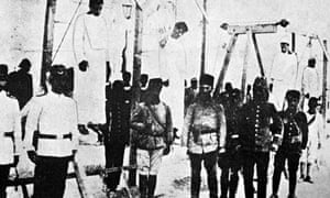 Ottoman soldiers posing in front of hanged Armenians, 1915. Photograph: AFP/Getty Images