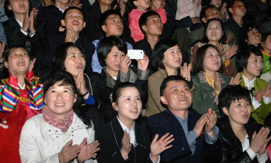 North Koreans watching fireworks during celebrations to mark the 103rd birth anniversary of late president Kim Il-sung at Mansu Hill in Pyongyang.