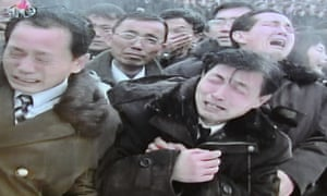 North Korean TV shows the public reaction to Kim Il-sung's funeral procession in Pyongyang.