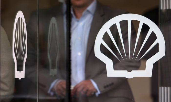 A visitor leaves the U.K. headquarters of Royal Dutch Shell Plc in London, U.K., on May 23, 2013.