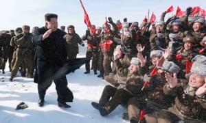 Kim Jong-Un waves to cheering Korean People's Army pilots on Mount Paektu.