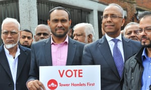 The then mayor of Tower Hamlets, Lutfur Rahman, centre right, stands next to his supporters during a campaign rally last May. That mayoral election will be rerun after Thursday's ruling.