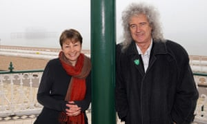 Caroline Lucas and Queen guitarist Brian May meet on the seafront in Brighton on 13 April.