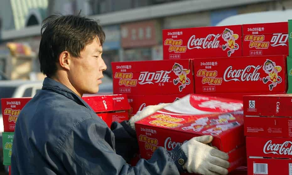 man unloading coca-cola packets