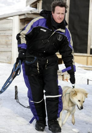 David Cameron organises his husky dogs on the Scott Turner glacier in Svalbard, inside the Arctic circle, Norway.
