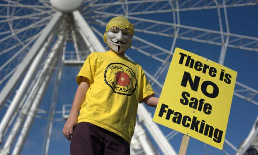 A protester in front of the big wheel in Manchester
