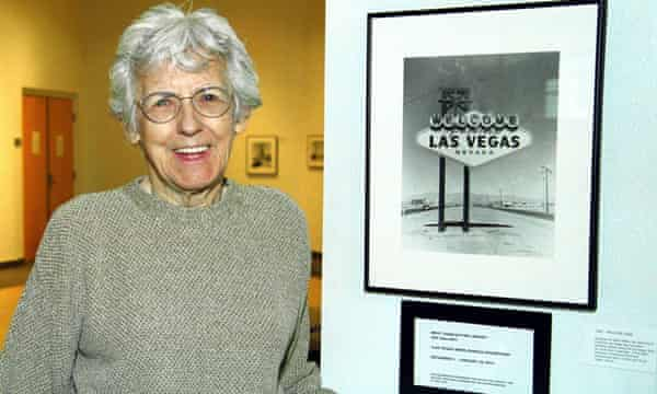 Betty Willis with a photograph of her sign.