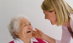 Young woman caring for older woman