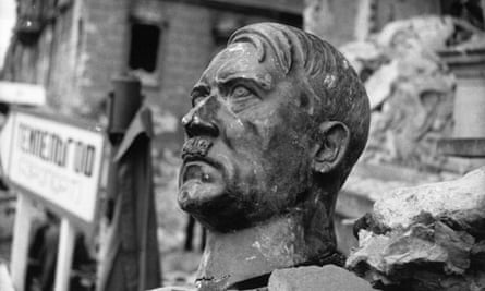 A bust of Adolf Hitler lies amid the ruins of the Reich Chancellery in 1945.
