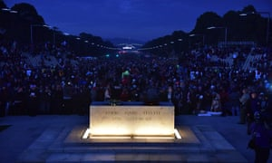 People look on during the dawn service at the Australian War Memorial in Canberra.