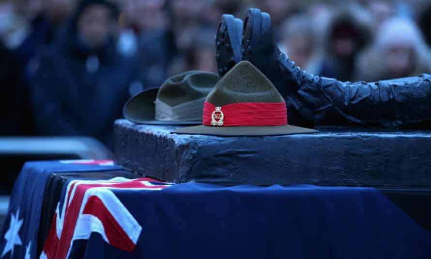 Australin and New Zealand army hats placed on a memorial at the Wellington Arch in London for Anzac Day.