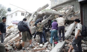 People search for survivors in the rubble of a destroyed building after an earthquake hit Nepal.