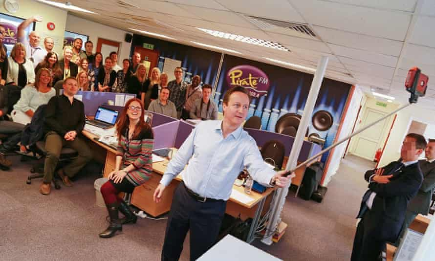 David Cameron uses a selfie stick on a visit to thhe Cornish radio Pirate FM offices.