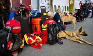 German search dogs and their handlers at the airport in Frankfurt am Main who are flying to Nepal in order to start assisting in relief efforts for the earthquake victims.