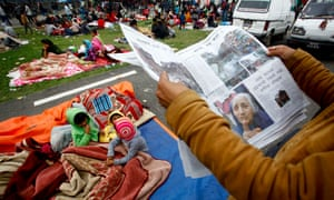 People take shelter at an open space in Kathmandu after the earthquake.