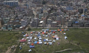 Tents are seen from an aeroplane window in an open field next to Tribhuwan international airport. Residents are too scared to stay inside their homes after the earthquake.