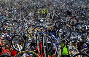 Thousands of cyclists hold up their bicycles to raise awareness about the need to improve cycling infrastructure in the city