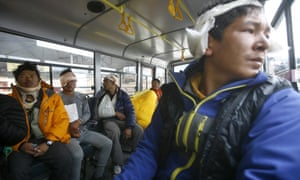 Injured Sherpa guides sit inside a bus in Kathmandu after they were evacuated from Everest base camp.