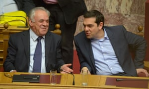 Greek prime minister Alexis Tsipras (right) talks to DPM Yannis Dragasakis, who said   Athens might be forced 'to take measures that until now we have tried to avoid'.