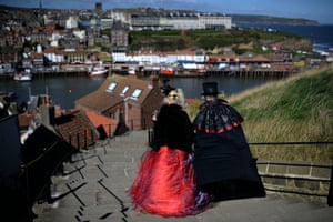 Gothic characters walk on their way to attend the Goth festival in Whitby, North Yorkshire