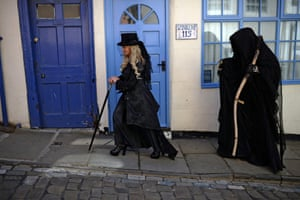 Gothic characters walk through the street during the Goth festival in Whitby, North Yorkshire