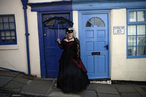 A gothic character poses for a photograph during the Goth festival in Whitby