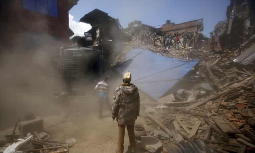 A damaged house is brought down during the search for trapped victims following Saturday's earthquake in Bhaktapur, Nepal.