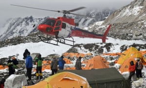 A rescue helicopter prepares to land and airlift the injured from Everest Base Camp.
