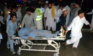 People transfer an injured man to a hospital in northernPakistan where scores of people have been killed and more than 200 others injured by a mini-cyclone.