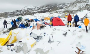 Tents lie damaged after an avalanche ploughed through Mount Everest base camp killing at least 18 people.