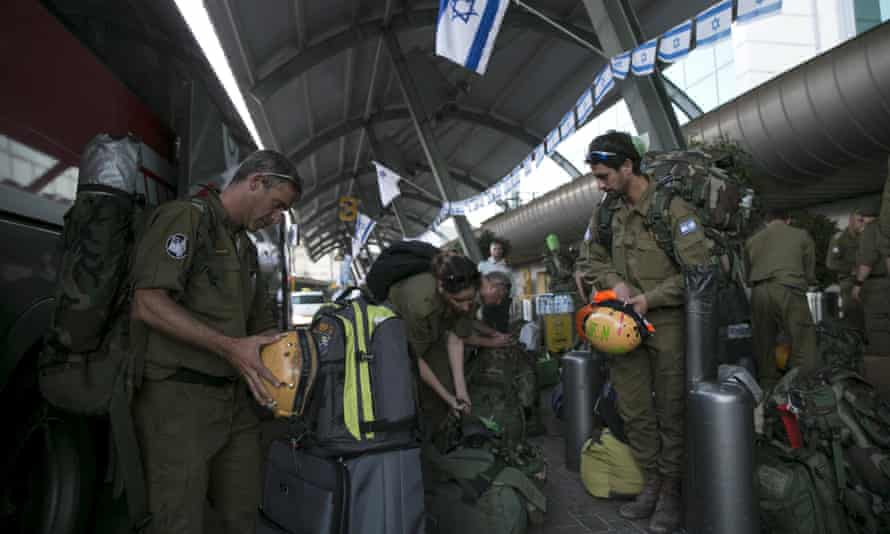 Israeli soldiers wait for a flight to Nepal from Tel Aviv. Many Israeli male couples have fathered children with the help of surrogate mothers in Nepal because surrogacy is illegal in Israel for same-sex couples.