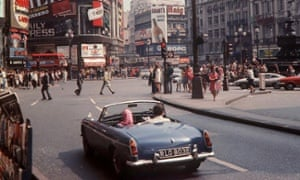 London's Piccadilly Circus in 1969, when car parking was still free in most of the capital.