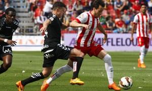 Almeria's midfielder Javier Espinosa, right, battles with Abraham Minero
