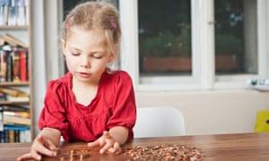 girl counting change