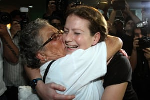 Greenpeace activist Ana Paula Maciel Alminhana is greeted by her grandmother as she arrives home in Brazil after two months' detention in Russia.