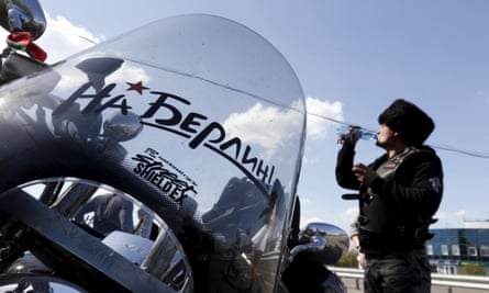 A member of Night Wolves participating in the group ride to commemorate the 70th anniversary of the Soviet victory over Nazi Germany. The sign reads 'On Berlin!'
