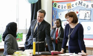 David Cameron and education secretary Nicky Morgan taking part in science lesson. Neither Labour nor the Conservatives have pledged to do as much as retain the current level of funding.