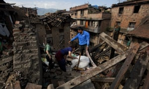 A Nepalese family collects belongings from their home destroyed in Saturday's earthquake, in Bhaktapur on the outskirts of Kathmandu.