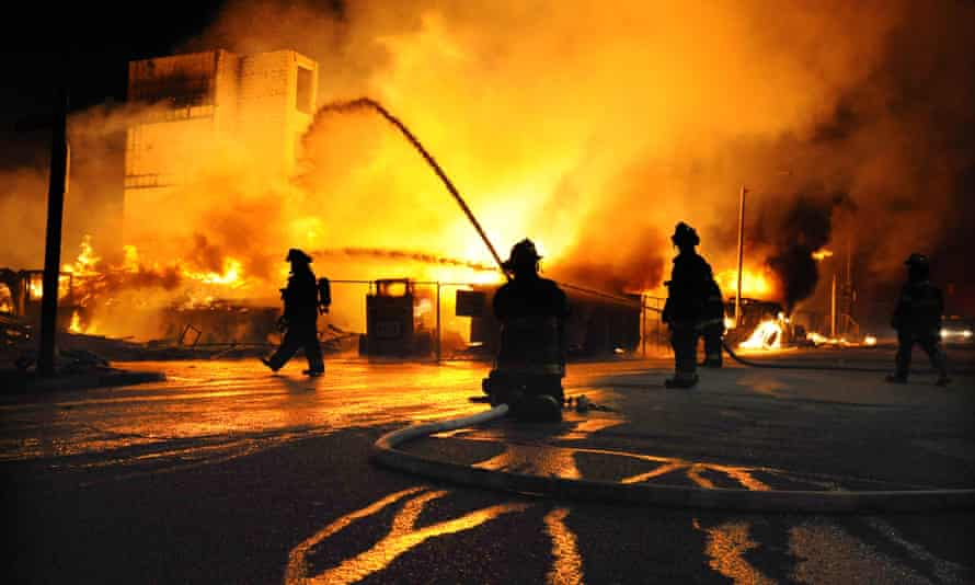 Baltimore firefighters battle a blaze at Gay and Chester Streets.