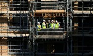 Prime Minister David Cameron (second left) visits the Weston Homes Aura building site, Edgware, London.
