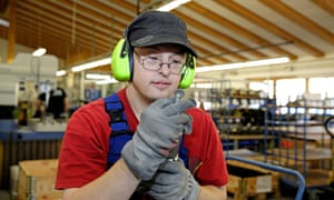 Young man with Down Syndrome in a workshop.