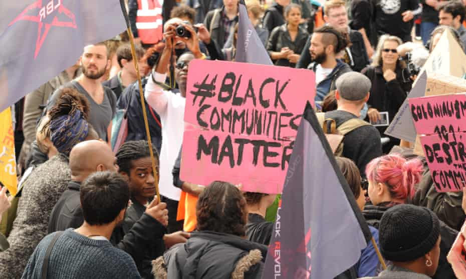 Hundreds join Reclaim Brixton in Windrush Square with banners and placards.