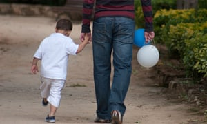 little boy holding fathers hand