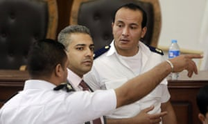 Canadian al-Jazeera English journalist Mohamed Fahmy, centre.